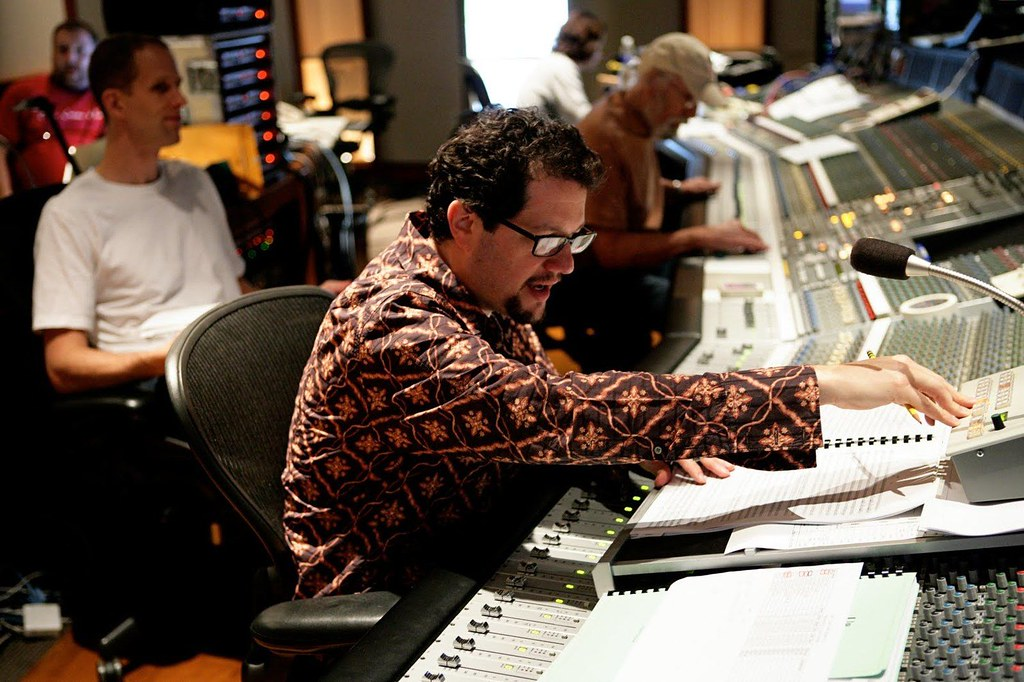 composer Michael Giacchino working at a sound mixing board