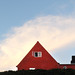 Red house with cloud by Kristjan Aunver