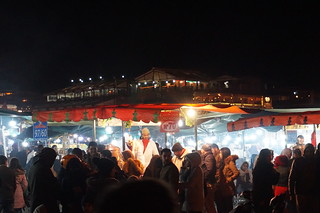 Jemaa El Fna képe. marrakech morroco arab northafrica outdoors sky city buildings old historic night dark lights jemaaelfna square market stalls smoke people crowded busy