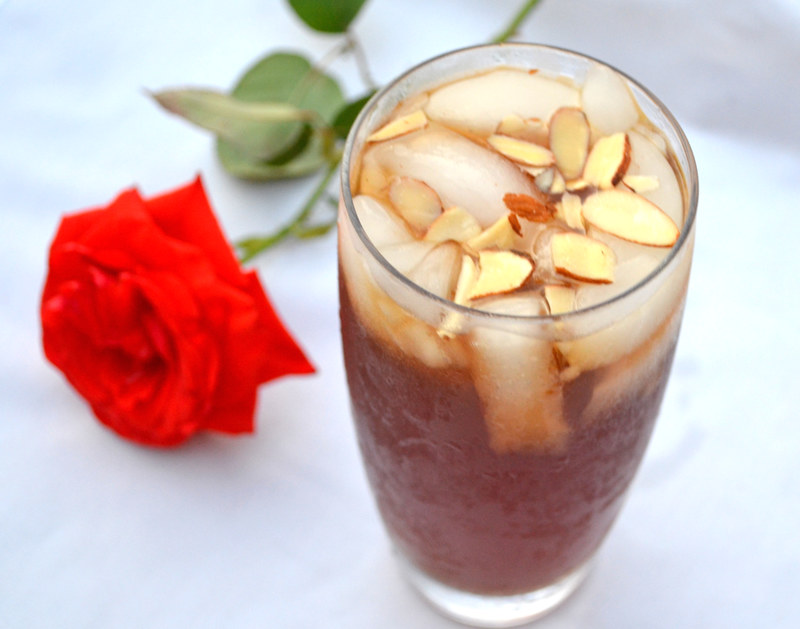 A refreshing and floral Middle Eastern drink inspired from Lebanon, Jallab is made with date molasses, a touch of rose mater and topped with slivered almonds.