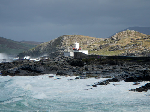 Lighthouse on the rocky foreshore at Valentia Island on Ireland's Wild Atlantic Way
