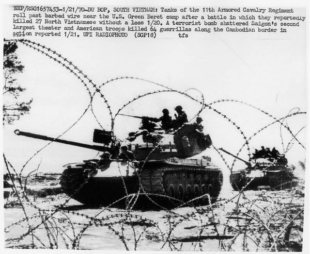 January 21, 1970 - Du Bop, South Vietnam: M-48 Tanks of the 11th Armored Cavalry Regiment roll past barbed wire near the U.S. Green Beret camp after a battle in which they reportedly killed 27 North Vietnamese without a loss 1/20