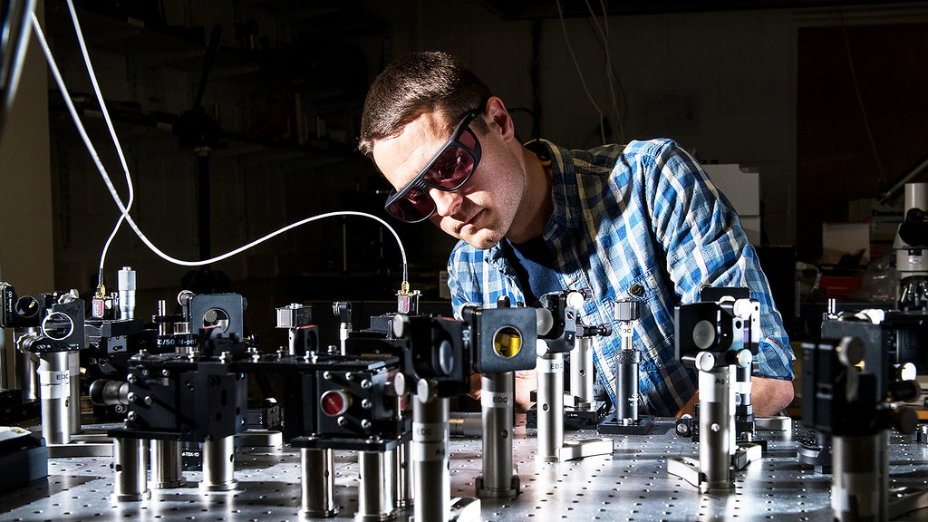A student working with a laser
