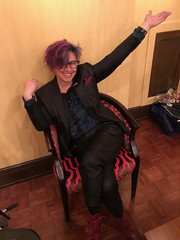 me on a fluorescent pink chair