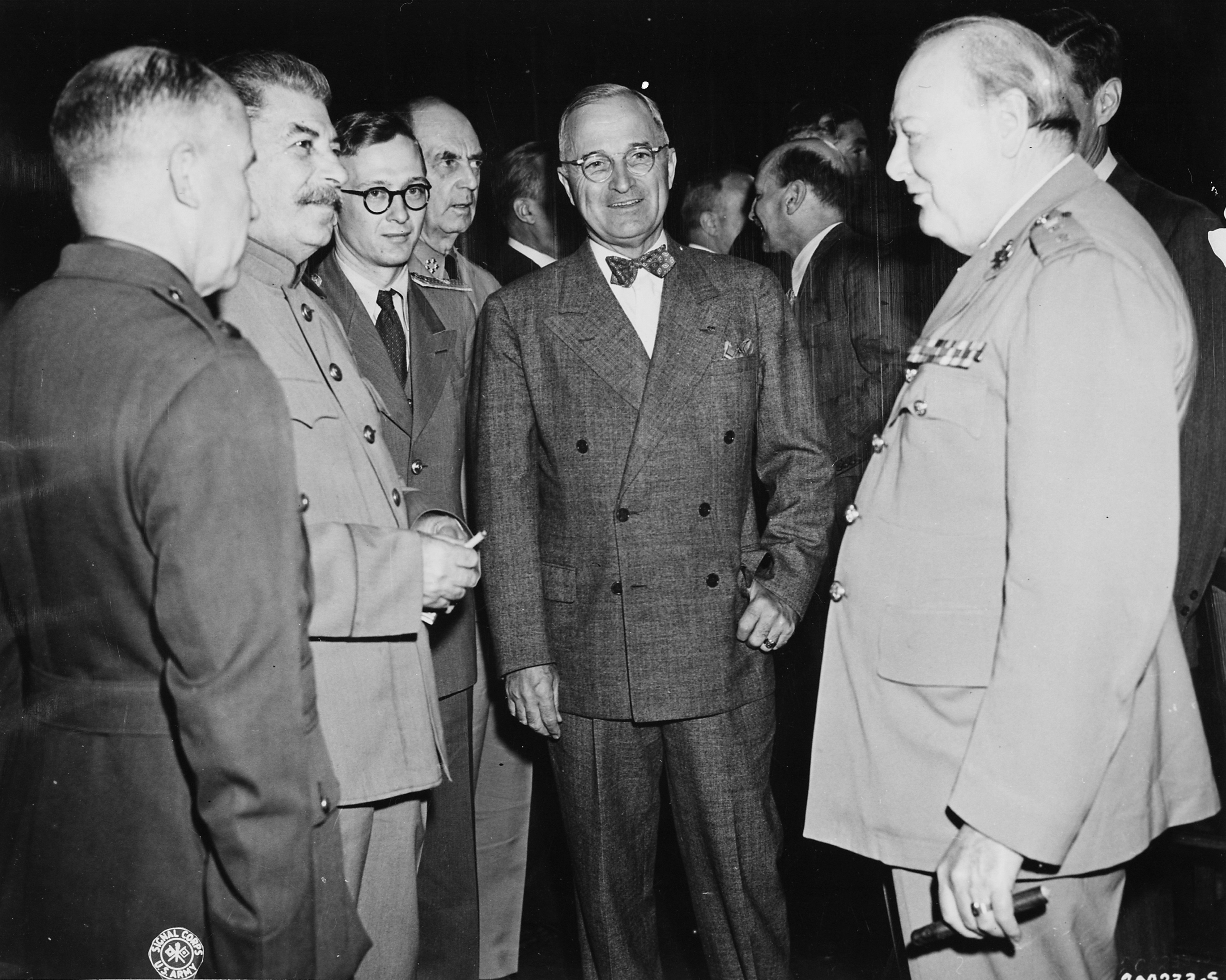 Joseph Stalin, Harry S. Truman and Winston Churchill taking a break at the Potsdam Conference held in Berlin from July 17 to August 2, 1945. Its result is the Potsdam Agreement, which sets out the fundamental questions of international law for the construction of a peaceful, democratic German state and the policy of the victors over Germany. Photo from the German Federal Archives, Allgemeiner Deutscher Nachrichtendienst - Zentralbild (Bild 183)