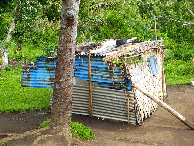 Local Ni-Vanuatu salvaged what they could of scattered remains of previous dwellings and roughly patched them together to provide some semblance  of shelter after the natural disaster event.