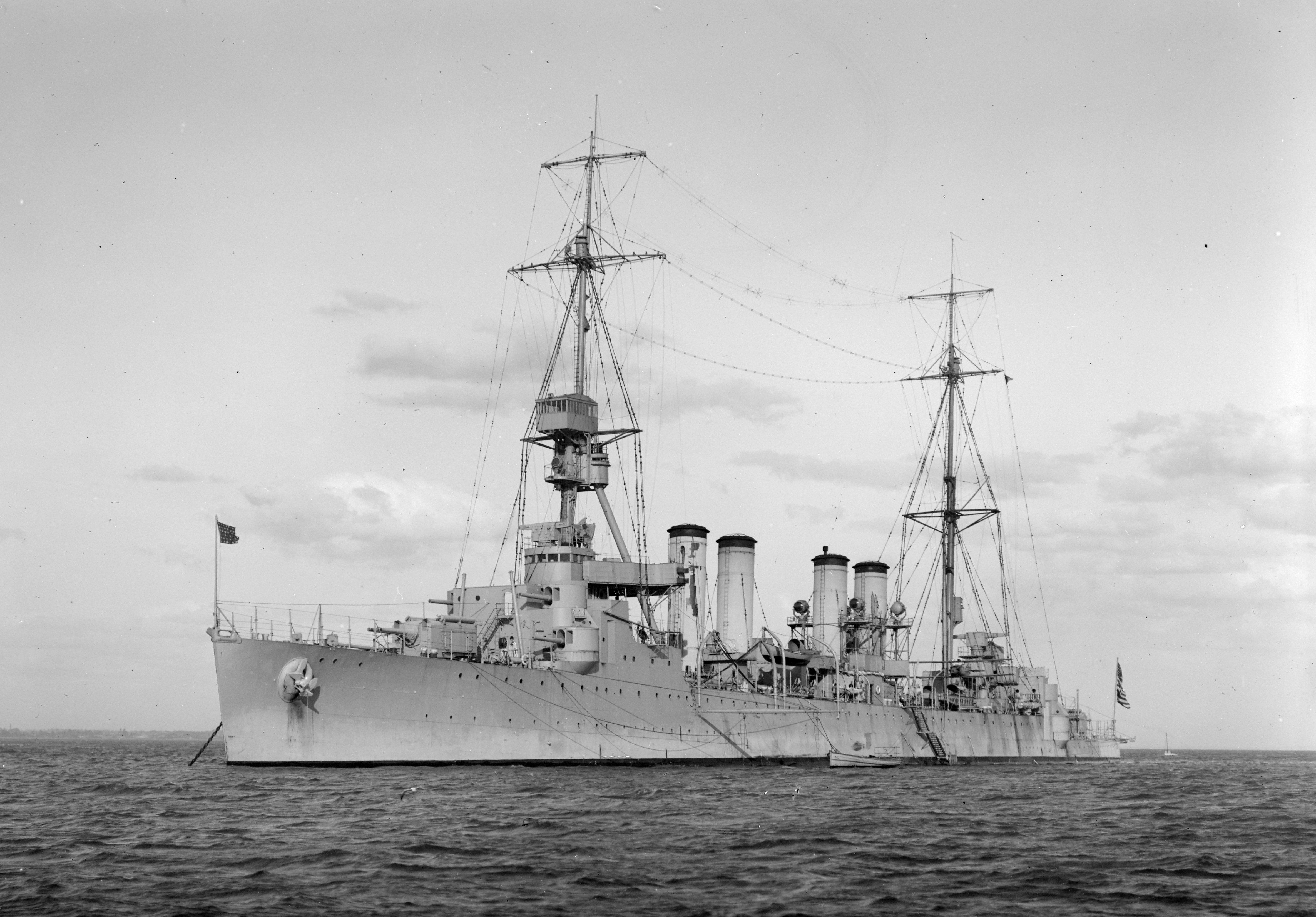 The U.S. Navy light cruiser USS Memphis (CL-13) at anchor in Australian waters. The photo was probably taken during Memphis' South Pacific cruise in June 1925.