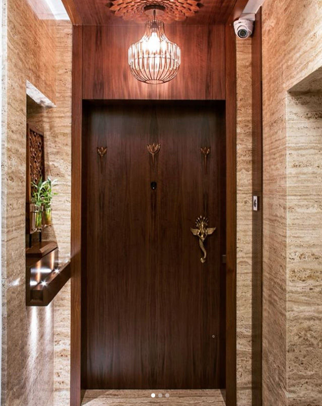 wooden main door - Ornate foyer with lotus carved base for a chandelier