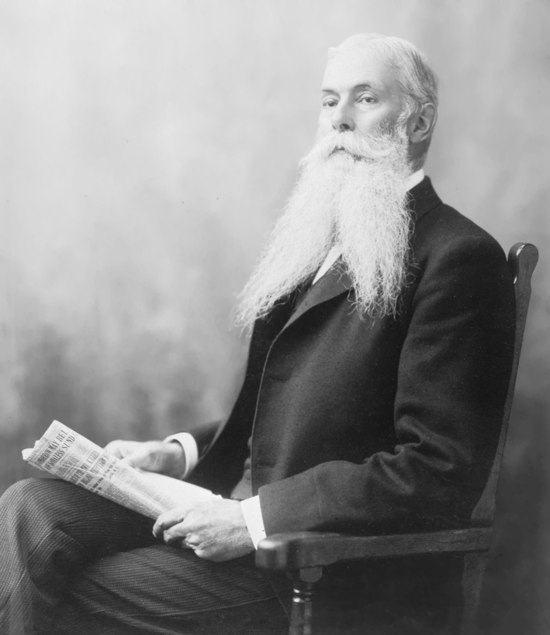 Sanford B. Dole holding a newspaper.