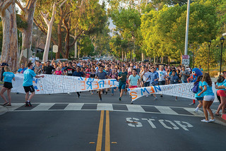 New students run through the gates on August 20, 2016.