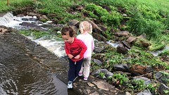The twins play on an overflowing waterfall yesterday
