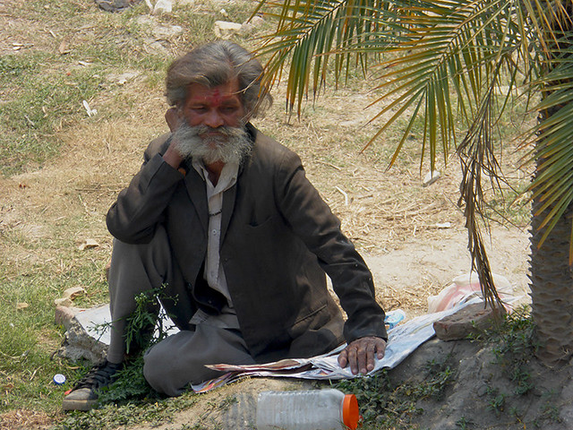 A homeless man in nepal sits wondering where the next meal will come from