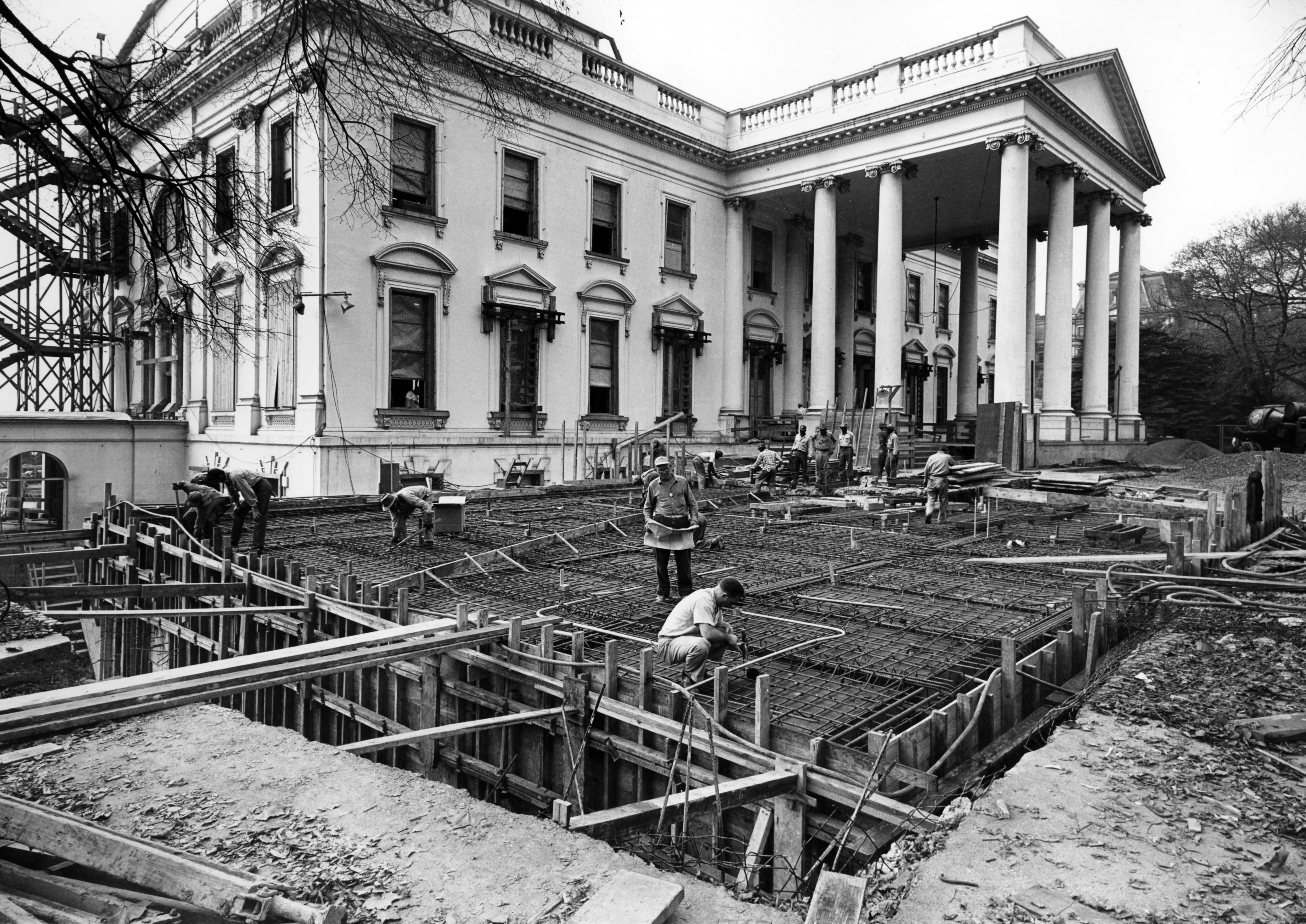 View of the northeast corner of the White House during renovation on November 6, 1950. Workmen are installing reinforced steel for laying of the concrete roofs of the Fan Room and other underground rooms in this area. Photo from he holdings of the National Archives and Records Administration, cataloged under the National Archives Identifier (NAID) 6982100.