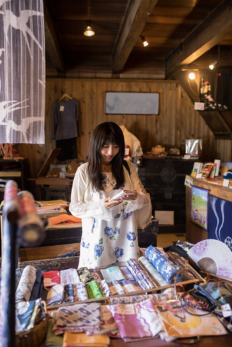 Young woman shopping in traditional Japanese store
