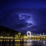 8. Mai 2018 - 20:55 - Lightning lighting up storm clouds above Elizabeth Bridge in Budapest, Hungary.  Elisabeth Bridge is the third newest bridge of Budapest, Hungary, connecting Buda and Pest across the River Danube. The bridge is situated at the narrowest part of the Danube in the Budapest area, spanning only 290 m. It is named after Elisabeth of Bavaria, a popular queen and empress of Austria-Hungary, who was assassinated in 1898. Today, her large bronze statue sits by the bridge's Buda side connection in the middle of a small garden.