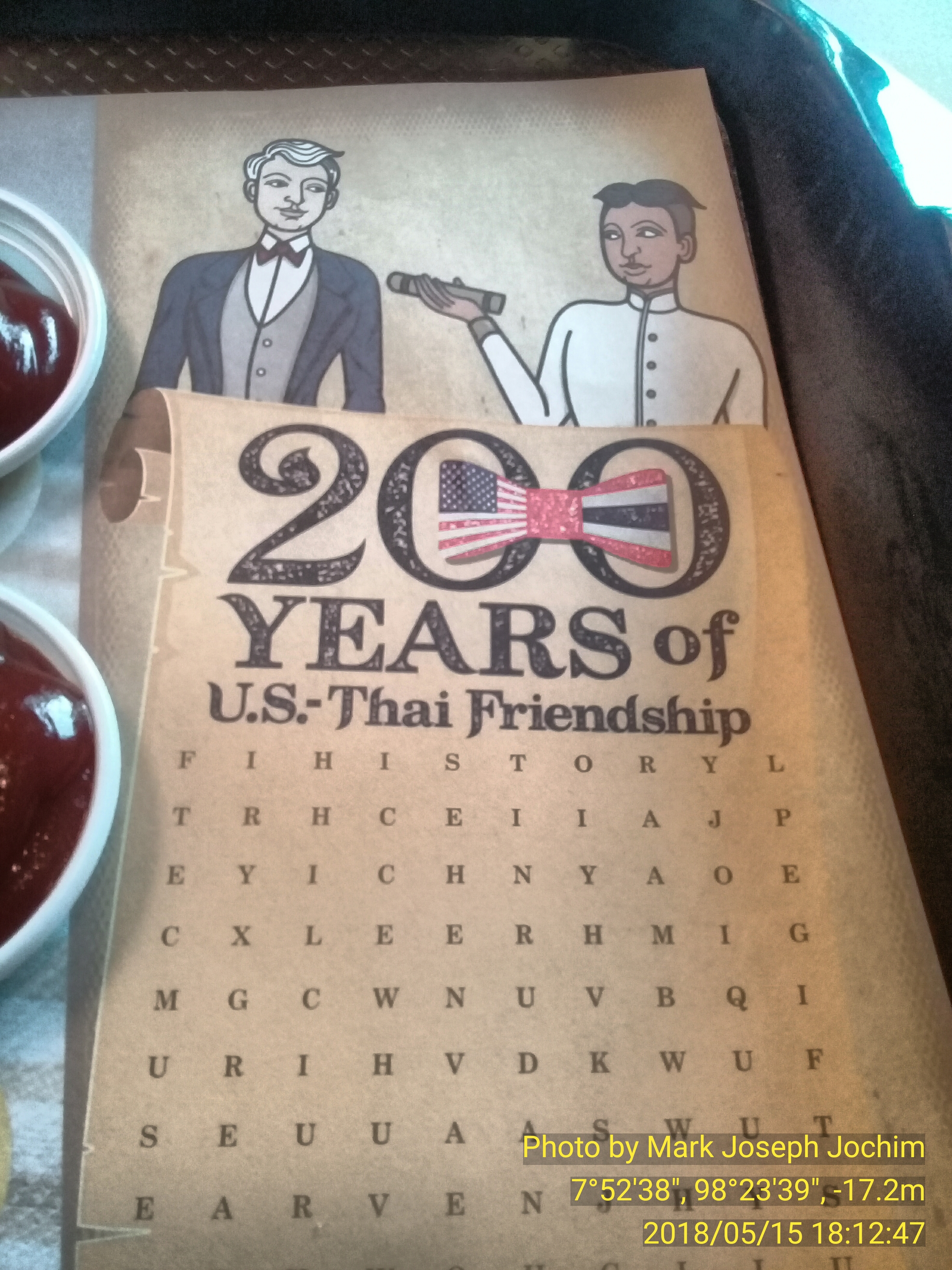 Inspiration for the Republica Phuketia stamp issue marking the Bicentennial of Thai-U.S. Friendship -- a tray-liner at McDonald's in Phuket, Thailand.