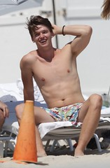 93019, MIAMI, FLORIDA - Saturday March 23, 2013. Patrick Schwarzenegger hits the beach with friends in Miami. Shirtless Patrick was having fun with his friends, jumping in the ocean with cocktail in hand, and getting close to a bikini clad girl. The son