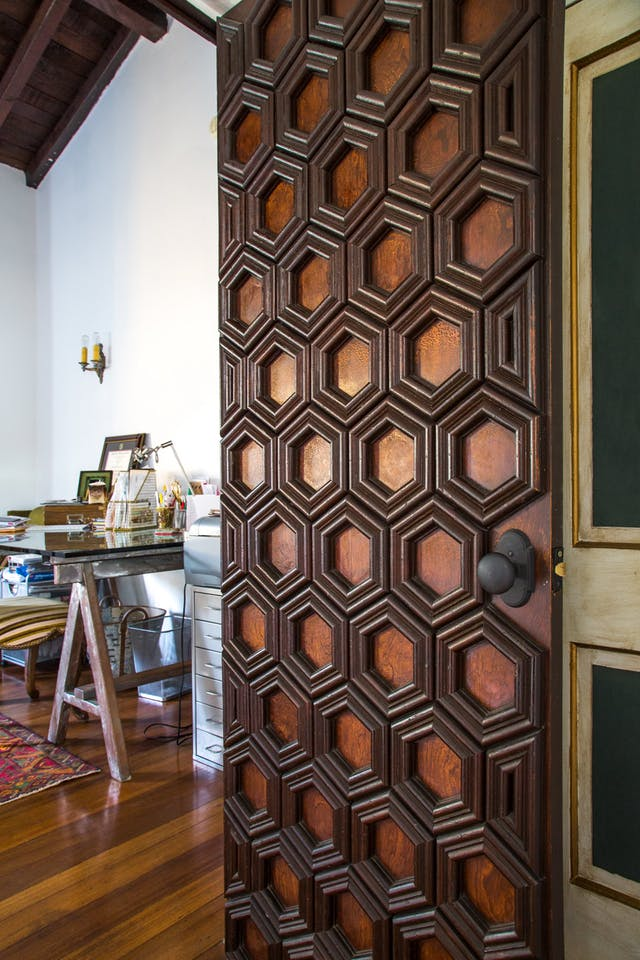 wooden main door renovated by adding 3D panels