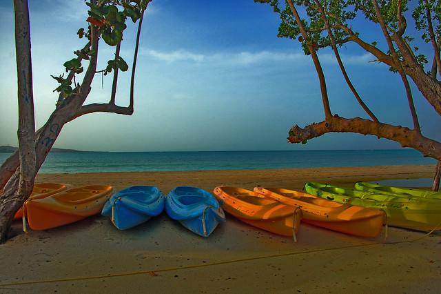 Early Morning Sun Across Kayaks On The Beach - Jamaica