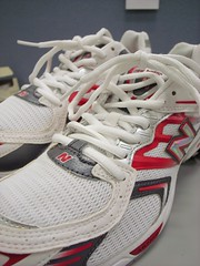tennis shoe(1.0), running shoe(1.0), sneakers(1.0), footwear(1.0), white(1.0), shoe(1.0), red(1.0), athletic shoe(1.0), pink(1.0),