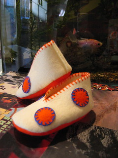 Bitty Booties with orange spots and fish.