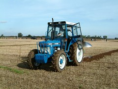 sowing(0.0), crop(0.0), agriculture(1.0), farm(1.0), field(1.0), soil(1.0), vehicle(1.0), plough(1.0), agricultural machinery(1.0), land vehicle(1.0), harvester(1.0), tractor(1.0),