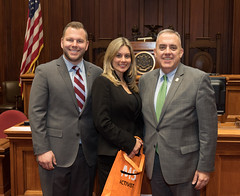 State Rep. Joe Polletta, MS activist Janelle Wilk, and State Senator Eric Berthel posed for a photo in the Senate Chamber.  Ms. Wilk was at the capitol for State Action Day for the Multiple Sclerosis Society.