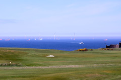 Turbines and boat from golfcourse