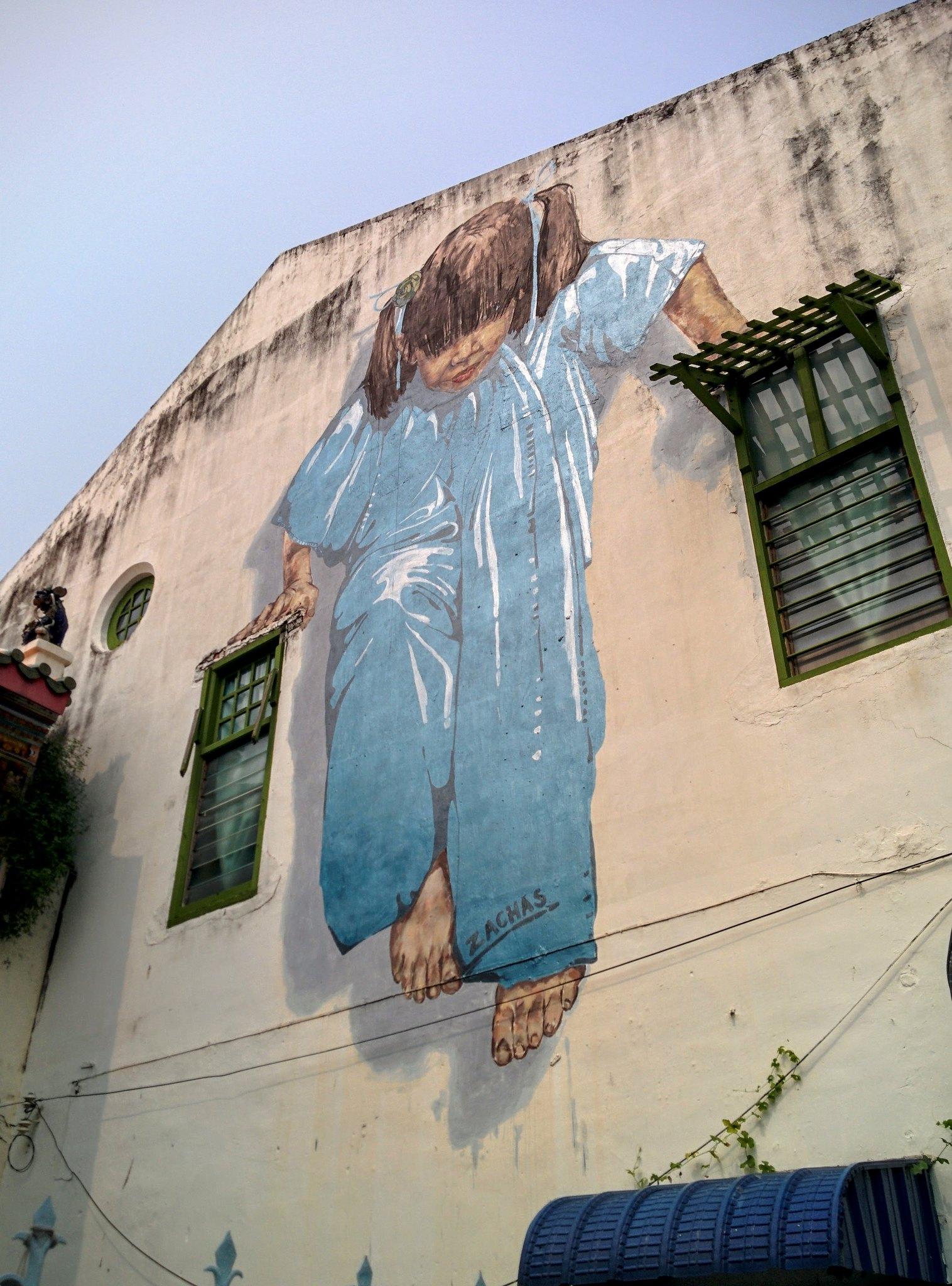 Street art of a girl doing pull ups