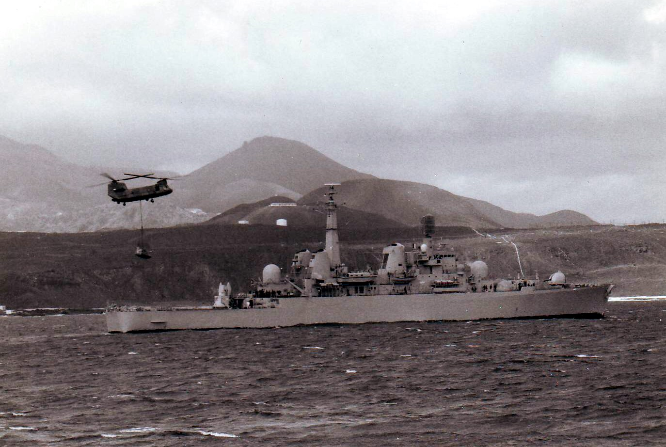HMS Bristol storing war supplies at Ascension Island, May 18, 1982.