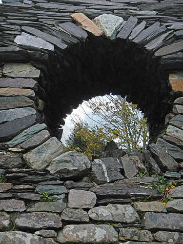 Stone sculpture in the garden that runs along the river in Sneem, Ireland