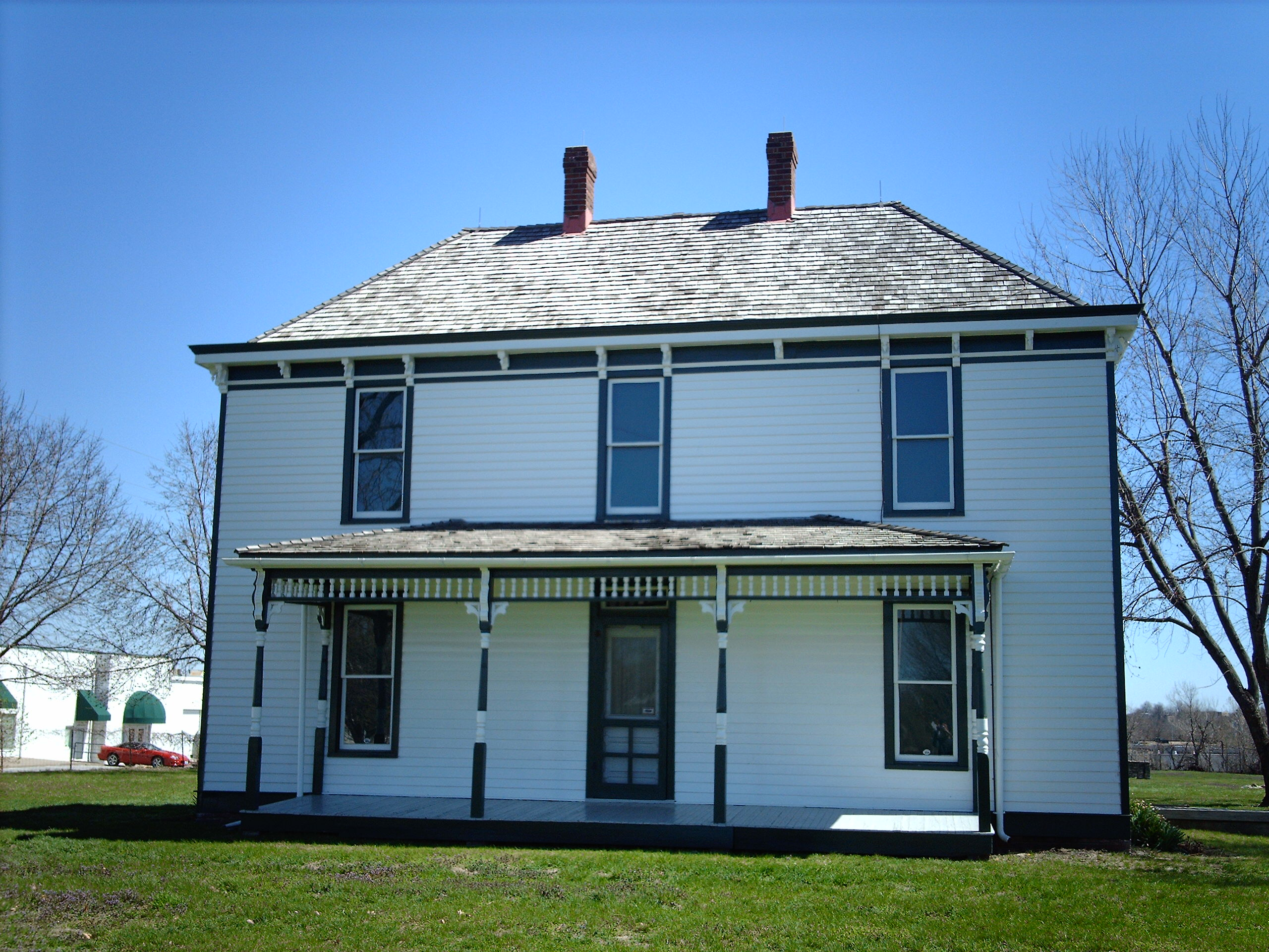 The Harry S. Truman Farm Home in Grandview, Missouri, part of the Harry S. Truman National Historic Site. A National Historic Landmark, the farmhouse at 12301 Blue Ridge Boulevard was built in 1894 by Harry Truman's maternal grandmother, and is the centerpiece of a 5.25-acre (2.12 ha) remnant of the family's former 600-acre (240 ha) farm. Truman worked the farm as a young man, from 1906–1917. Photo taken on March 31, 2006.