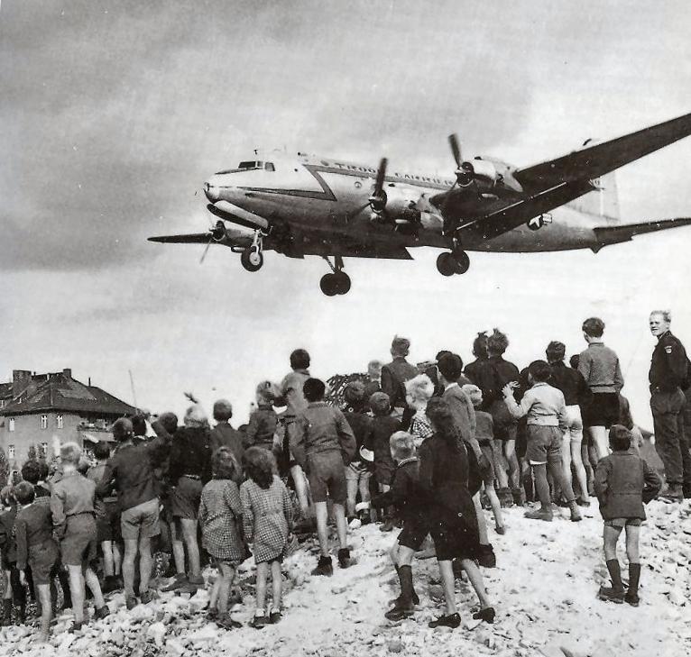 Berliners watch a Douglas C-54 Skymaster land at Tempelhof Airport, 1948