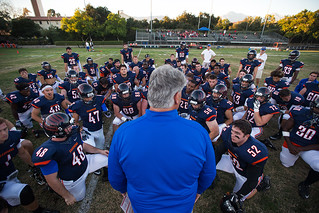 Coach Roger Caron addresses his team before a game on Sept. 10, 2016.