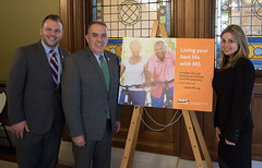 State Rep. Joe Polletta, State Senator Eric Berthel and MS activist Janelle Wilk posed for a photo during State Action Day for the Multiple Sclerosis Society.