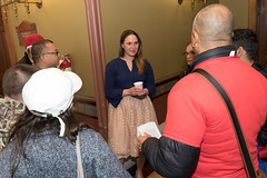 Rep. Stephanie Cummings talks with AIDS activists who were at the capitol to lobby for  increased awareness of the disease.