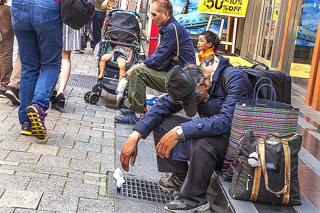 Slumped man on Ameyoko--Tokyo