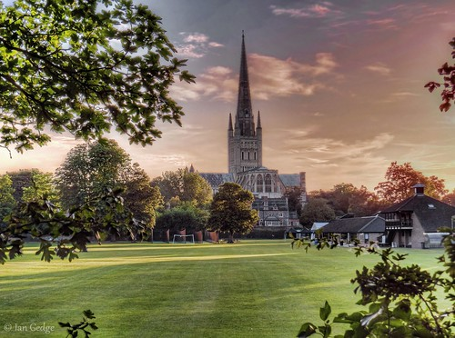 england uk britain eastanglia norfolk norwich cathedral city evening sunset spring grass landscape