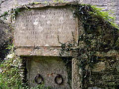 Tombstone at Muckross Abbey Cemetery in Killarney National Park, Ireland