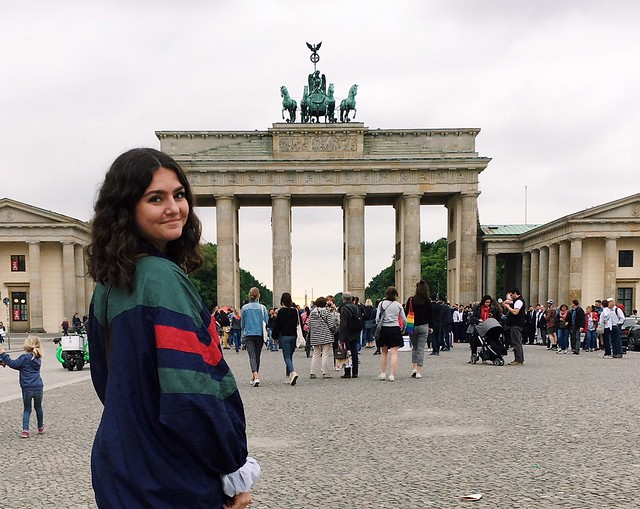 Student standing in front of the Brandenburg Gate in Berlin.