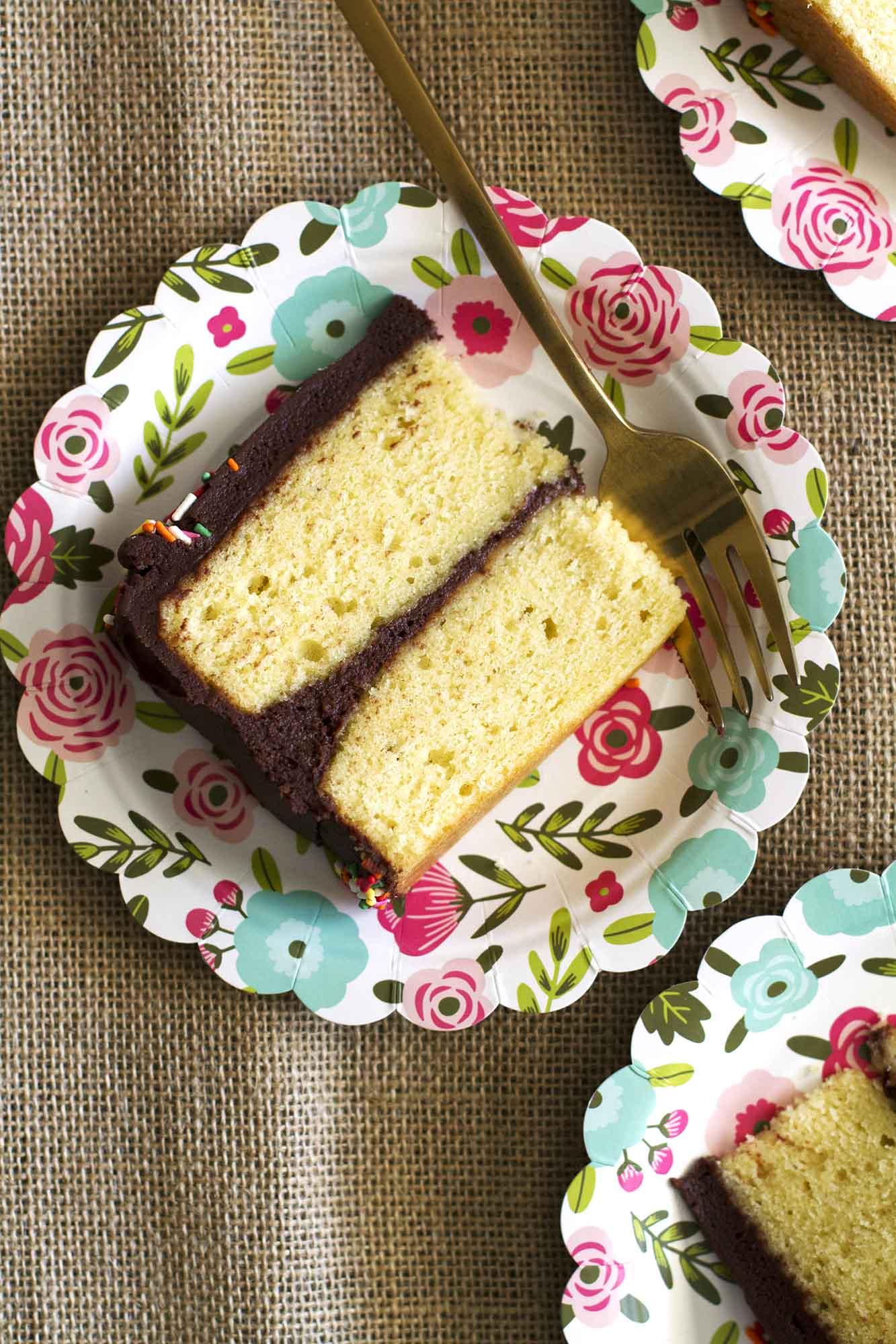 Yellow Birthday Cake with Chocolate Buttercream Frosting   girlversusdough.com @girlversusdough