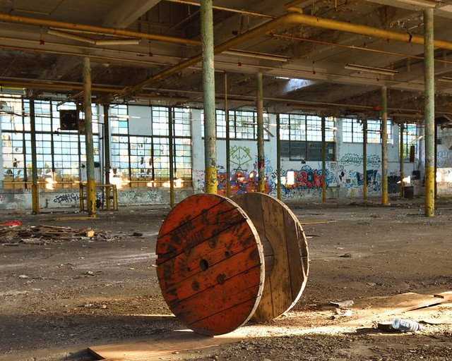 cable spool in abandoned mill