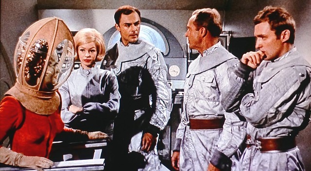 Allan Brenner (John Saxon) saved the alien Queen (Florence Marly) and brought her aboard  the Earthship in