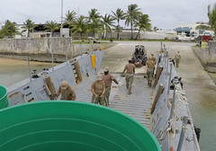 Seabees from NMCB 11 load water catchment project materials onto a U.S. Army landing craft mechanized (LCM) in Kwajalein, April 19. (U.S. Navy/CE2 Joshua Zapien)
