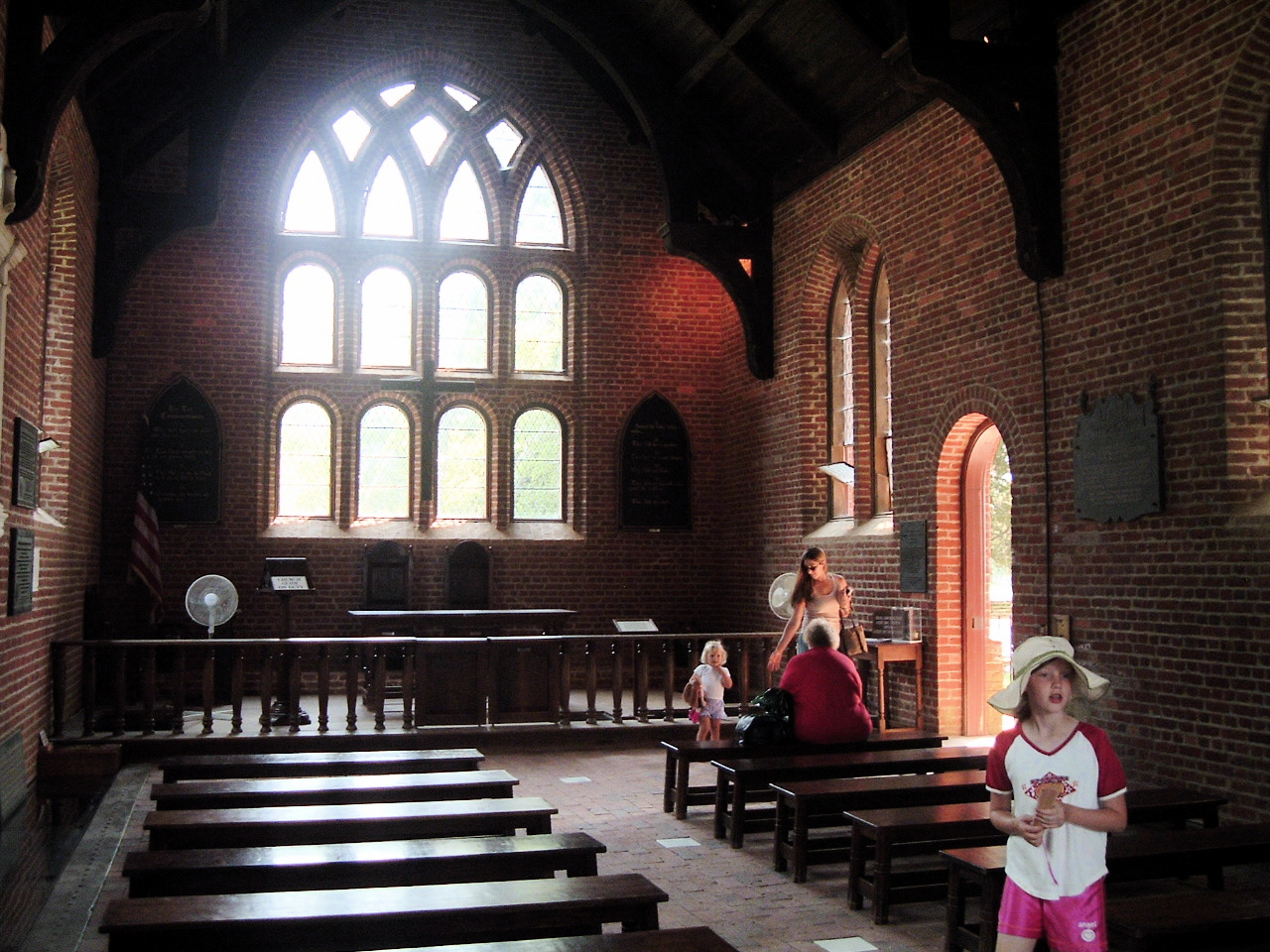 The inside of the current Jamestown Church, upon the general site of the original and the location where the first law in America was made. The church encompasses the only remains of a Jamestown structure existing from the time of its settlement and habitation. Although the main body of the church is a 1906 reconstruction, the tower is remaining original feature, dating to ca. 1650. The tower is slightly over 18 feet square and the walls are three feet thick at the base. Originally the tower was about 46 feet high (ten feet higher than the ruins) and was crowned with a wooden roof and belfry. It had two upper floors as you can see from the large beam notches on the inside. Six small openings at the top permitted light to enter and the sound of the bell or bells to carry across river and town. Photo taken on July 1, 2006.