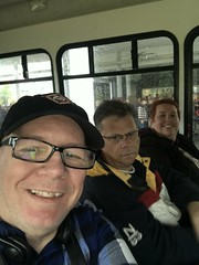 One of us is not thrilled - Larry, Mark and Gillian on the bus to Graceland - Memphis