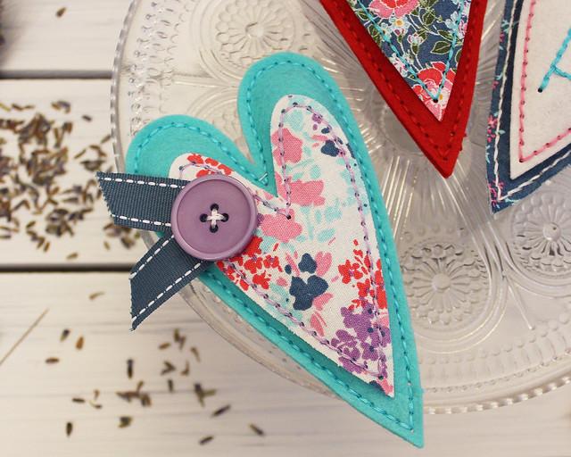 LizzieJones_StitchingAmbassador_StitchedPrimitiveHeart_LavenderSachets_Button&Ribbon