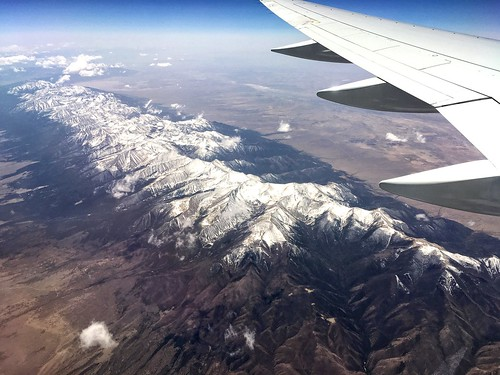 windowseat boeing757300 iphonese snapseed stevefrenkel therockymountains snowcappedmountains overcolorado