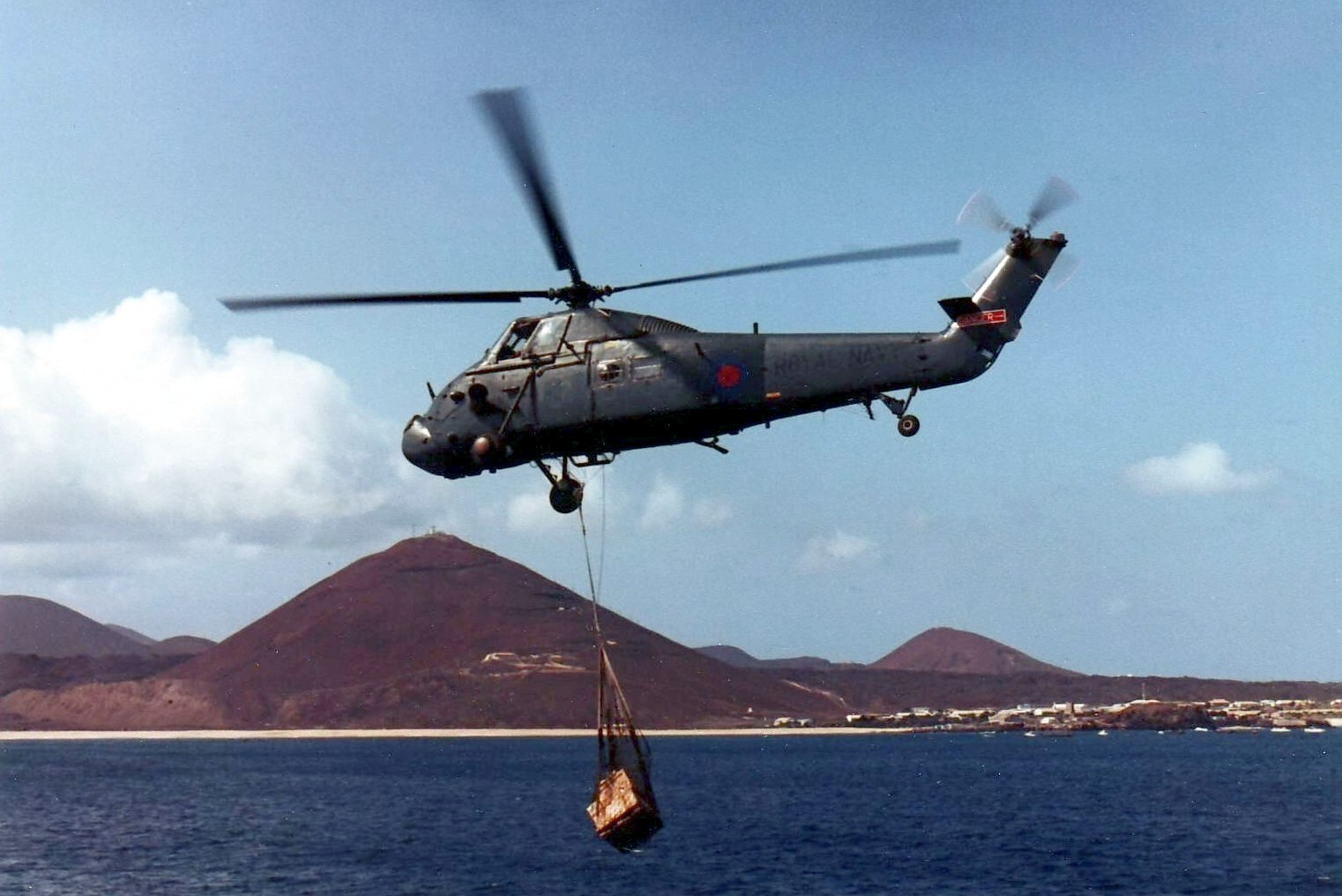 A Westland Wessex helicopter delivers supplies at Ascension Island in May 1982.