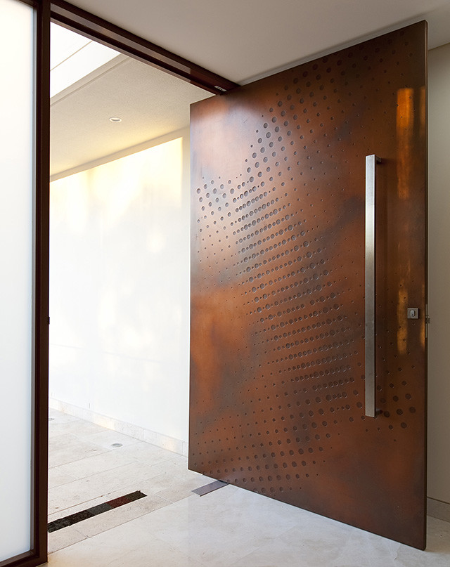 a textured wooden main door design